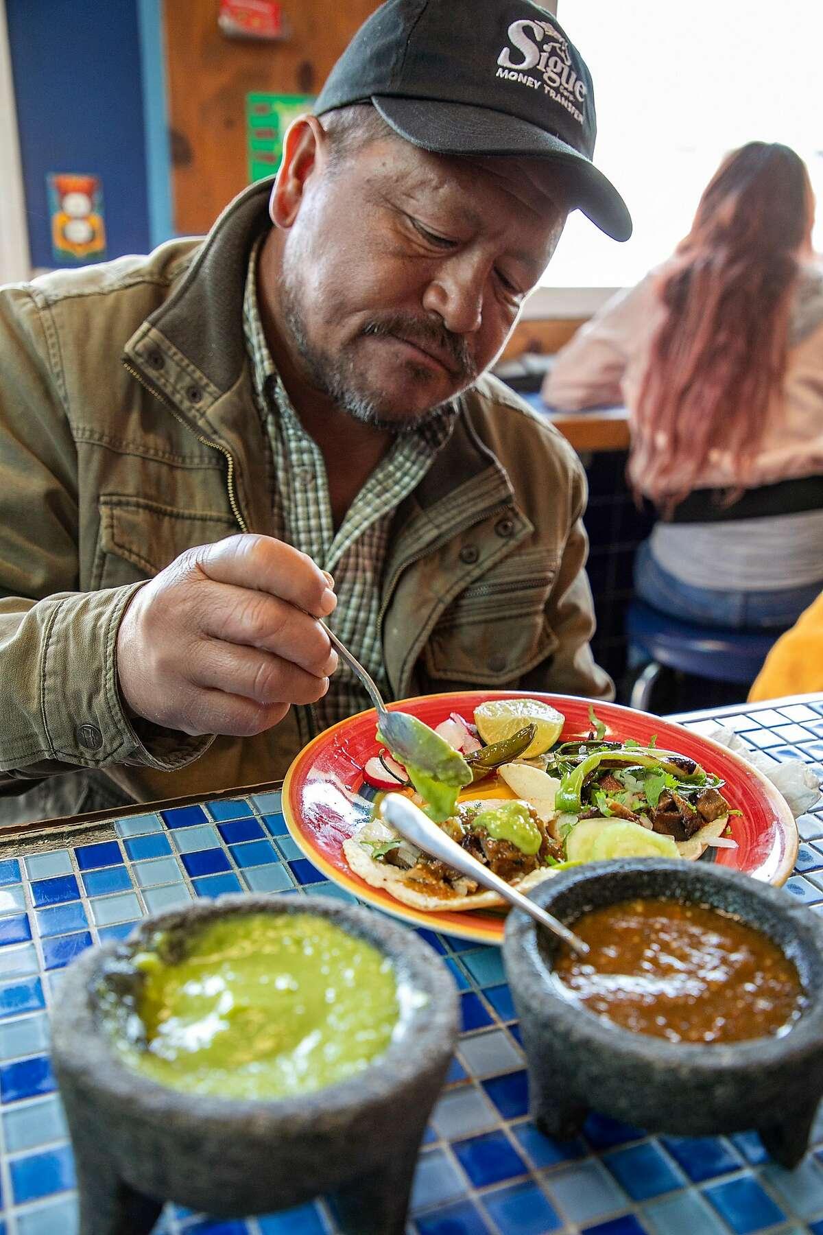 Raymundo Arias, of Salinas, eats beef tongue tacos at Eva's Cafe on Tuesday, August 20, 2019 in Salinas, Calif.