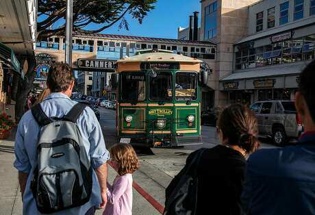 The MST Monterey Trolley prepares to stop along Cannery Row on Wednesday, August 21, 2019 in Monterey, Calif.