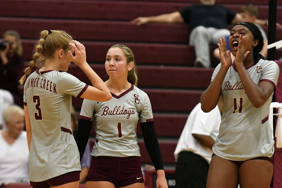 Summer Creek junior Imari Wilson (11) gets pumped up with teammates BreAnna McDonald (2) McKay Wilson (3) and Jozie Dhayer (1) against George Ranch during the 3rd set of their non-district matchup at SCHS on August 27, 2019. Photo: Jerry Baker, Houston Chronicle / Contributor / Houston Chronicle