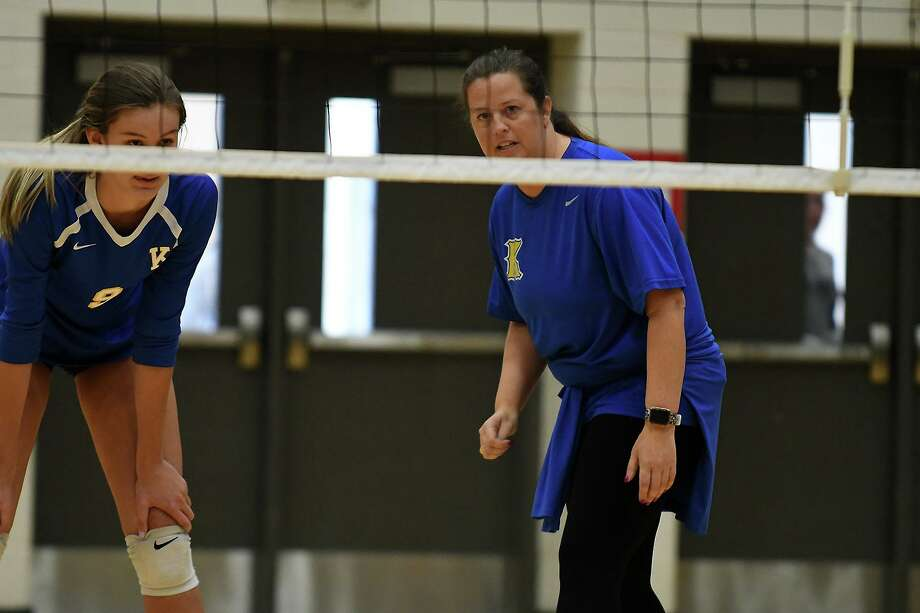 Klein Head Volleyball Coach Kate Zora, right, pumps up sophomore middle blocker Kierstyn McFall during their pool play matchup Magnolia West in the 2019 Katy/Cy-Fair Volleyball Classic at Cy Parks High School on August 8, 2019. Photo: Jerry Baker, Houston Chronicle / Contributor / Houston Chronicle