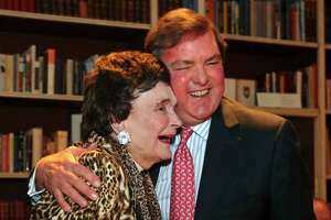 Former San Antonio Mayor Lila Cockrell hugs J. Bruce Bugg Jr., chairman and trustee The Tobin Endowment, during her 90th birthday reception held Jan. 19, 2012, at the Tobin Estate.