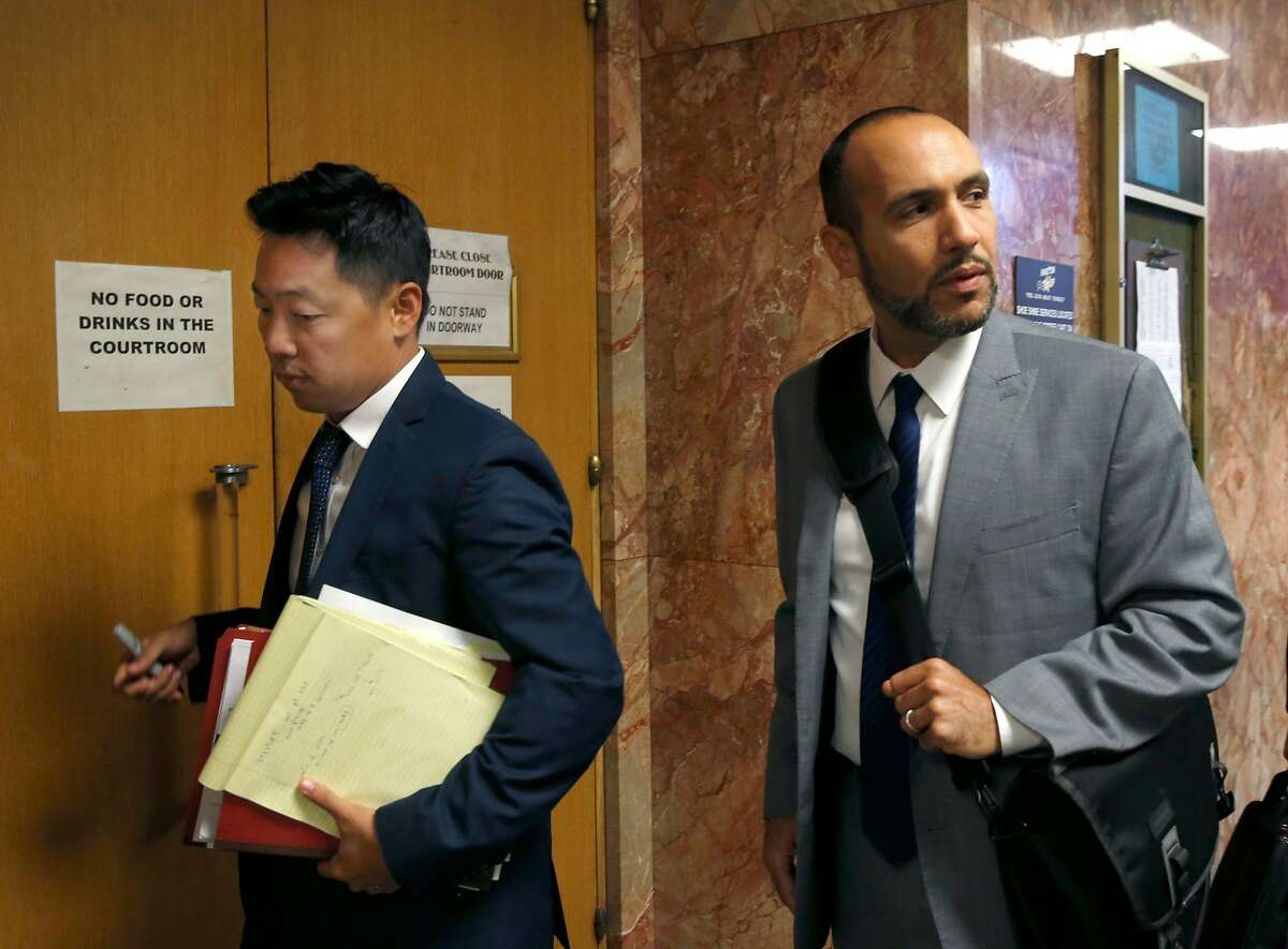 Deputy District Attorney Edward Chang and Deputy Public Defender Saleem Belbahri walk into Judge Christine Van Aken's courtroom for a hearing for Austin James Vincent, who is accused of attacking a woman outside of her Embarcadero condo building, at the Hallof Justice in San Francisco, Calif. on Tuesday, Aug. 20, 2019.