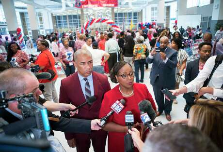 Houston Independent School District Interim Superintendent Dr. Grenita Lathan and Kashmere High School principal Reginald Bush speak with the media following a celebration marking the school's meeting of state expectations for the first time in 11 years at the school in Houston, Thursday, Aug. 15, 2019.