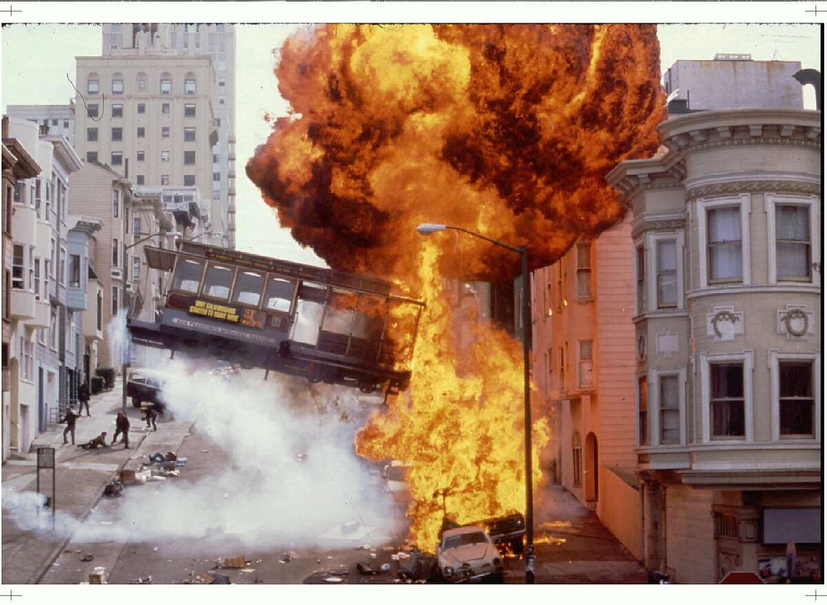 LOA03:THE ROCK:LOS ANGELES,CALIFORNIA,3JUN96- An explosion and a flying cable car in downtown San Francisco are shown in a scene from the new action drama