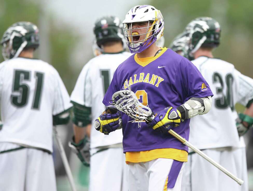 UAlbany attack Miles Tompson reacts after scoring a goal against Loyola in a first-round men's lacrosse NCAA Tournament game at Ridley Athletic Complex in Baltimore on Saturday, May 10, 2014. (Brian Schneider / www.ebrianschneider.com)