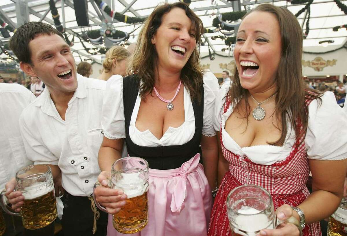 MUNICH, GERMANY - SEPTEMBER 16: Guests in typical Bavarian dress enjoy the opening day of the October Fest in Munich on September 16, 2006 in Munich, Germany. The 173rd Oktoberfest, for years the biggest public festival in the world, is expected to draw 6 to 7 million visitors this year. (Photo by Alexander Hassenstein/Getty Images)