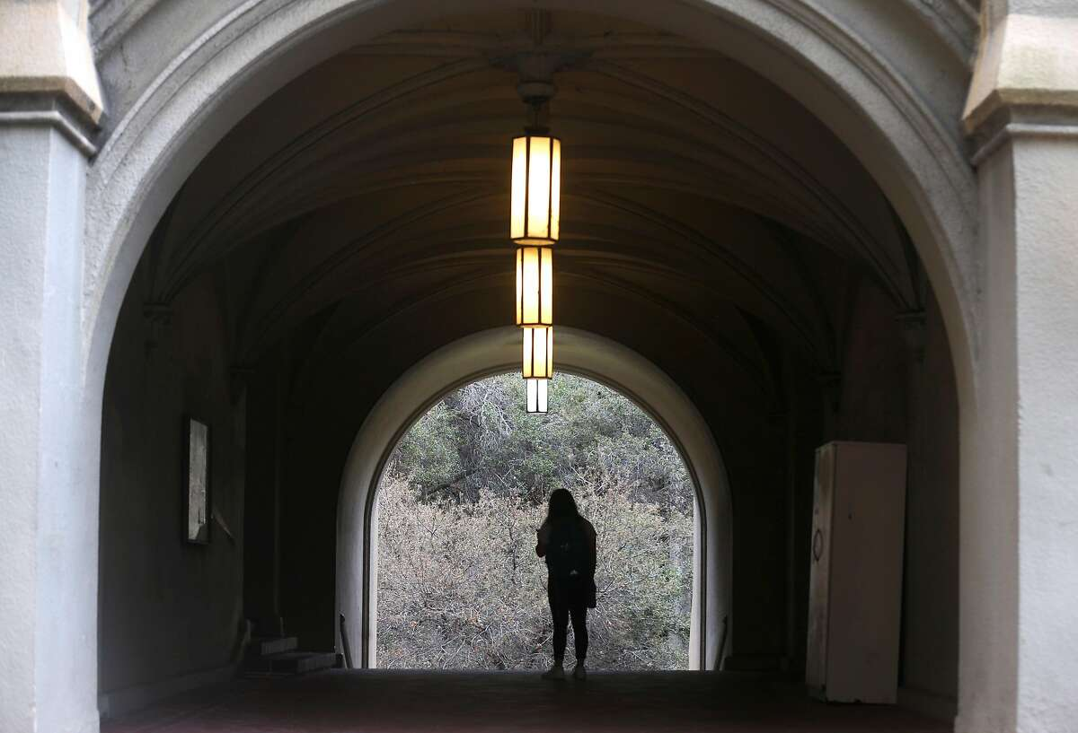 """A student walks through the portico of Stephens Hall at UC Berkeley on Wednesday, Aug. 28, 2019. Stephens Hall is among six structures that have been rated as """"very poor"""" in a seismic analysis of buildings on the campus."""