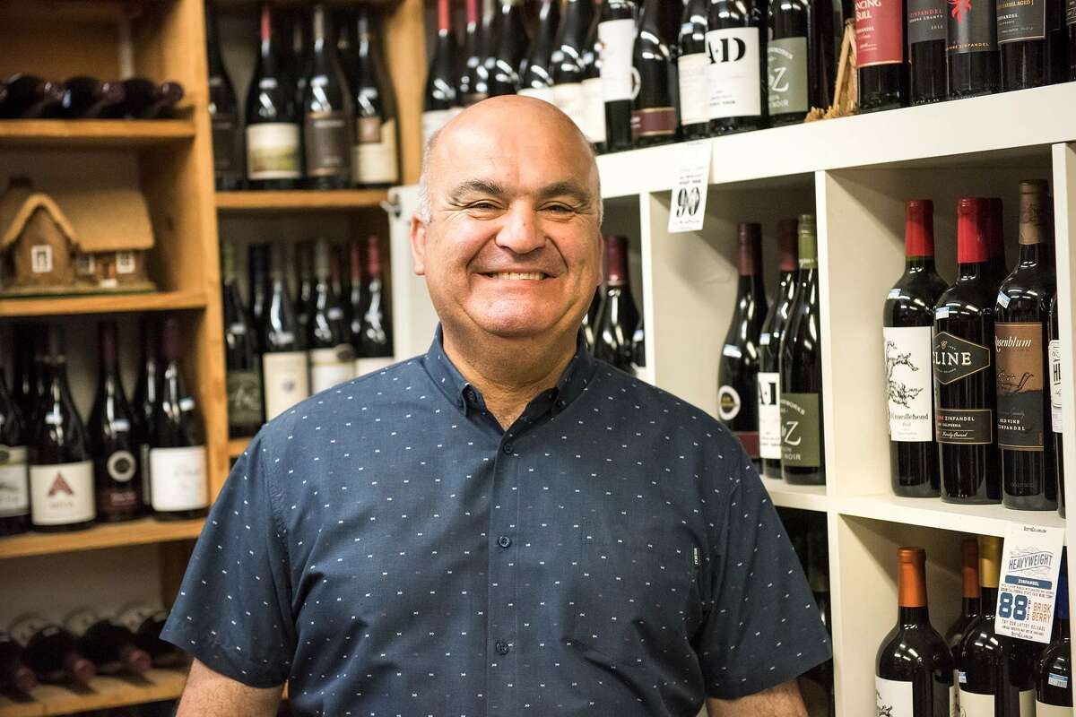 Elie Chahwan, owner of Valentino Market, poses in a wine cellar he built himself.
