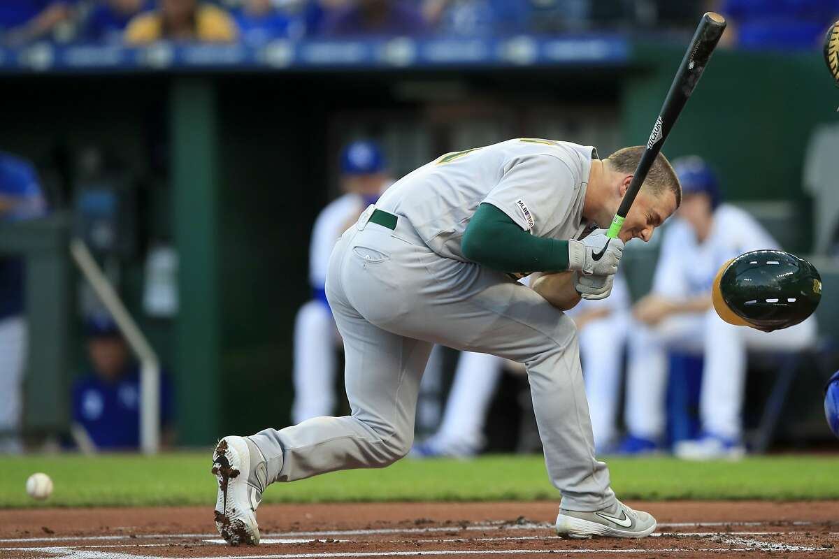 Oakland Athletics' Matt Chapman is hit by a pitch from Kansas City Royals starting pitcher Jakob Junis during the first inning of a baseball game at Kauffman Stadium in Kansas City, Mo., Wednesday, Aug. 28, 2019. (AP Photo/Orlin Wagner)