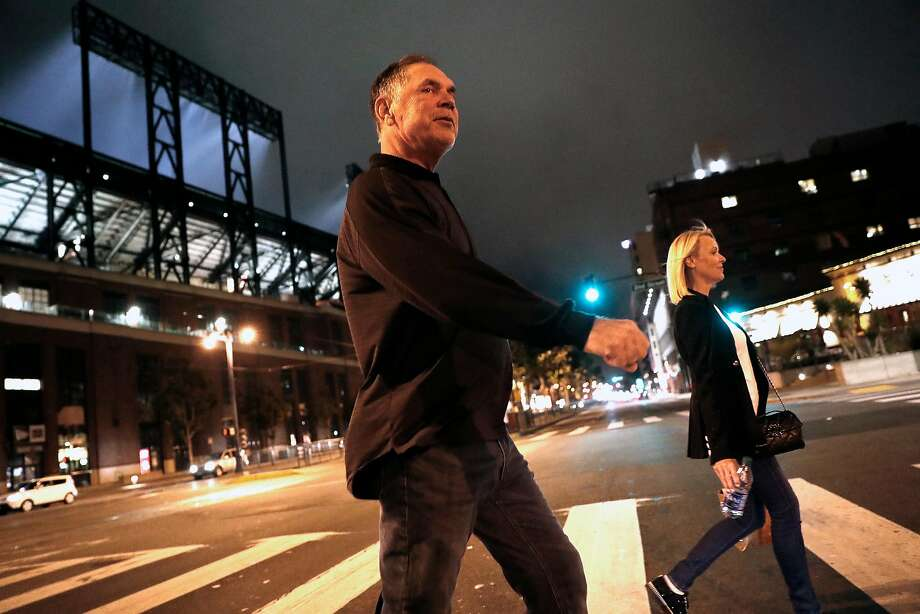 """Giants manager Bruce Bochy and his wife, Kim, head home after a long day at Oracle Park on Tuesday. """"You're going to have these tough losses,"""" Bruce says. """"What's important is how you deal with them. ... We're off tomorrow, then we gotta bounce back."""" Photo: Scott Strazzante / The Chronicle"""