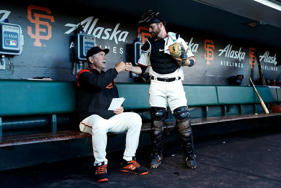 San Francisco Giants' manager Bruce Bochy fist bumps catcher Stephen Vogt before Giants play Arizona Diamondbacks in MLB game at Oracle Park in San Francisco, Calif., on Tuesday, August 27, 2019. Photo: Scott Strazzante, The Chronicle