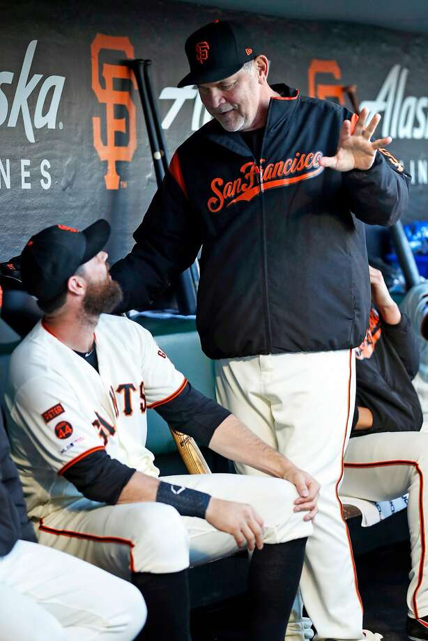Giants manager Bruce Bochy chats with Brandon Belt in the dugout before Giants' game against the Arizona Diamondbacks at Oracle Park on Aug. 27, 2019. Photo: Scott Strazzante / The Chronicle