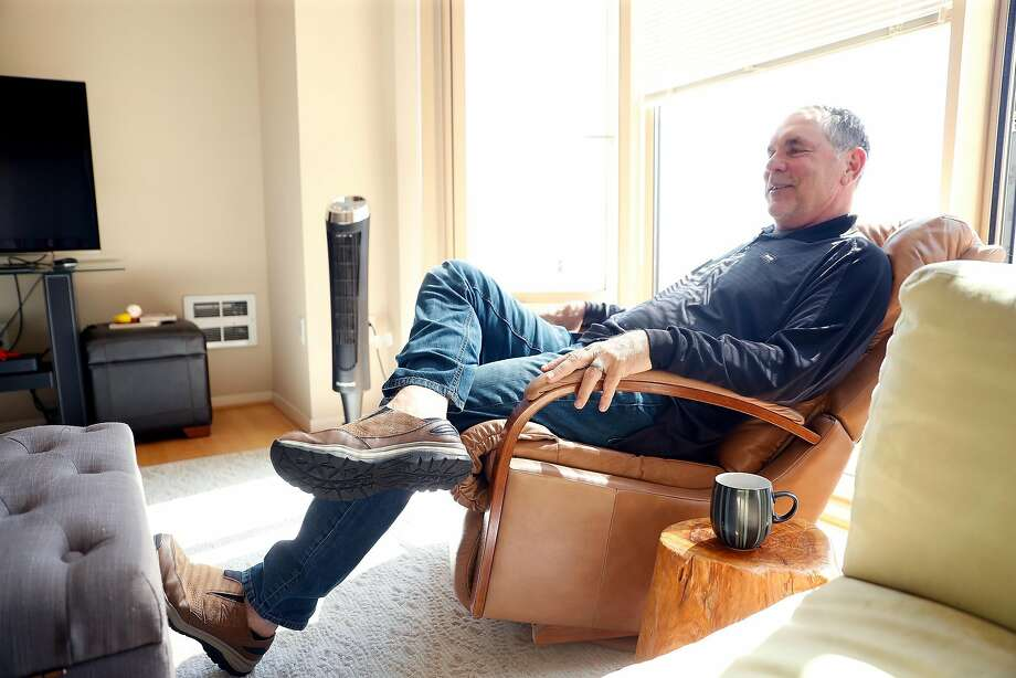Giants manager Bruce Bochy kicks back the morning before a busy day of transactions and baseball in San Francisco on Tuesday. Bochy and wife Kim have owned the condo across from Oracle Park for seven years. Photo: Scott Strazzante / The Chronicle