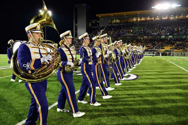 UAlbany's marching band takes the field during halftime of their home opener against Rhode Island Saturday Sept. 14, 2013, in Albany,NY. (John Carl D'Annibale / Times Union)