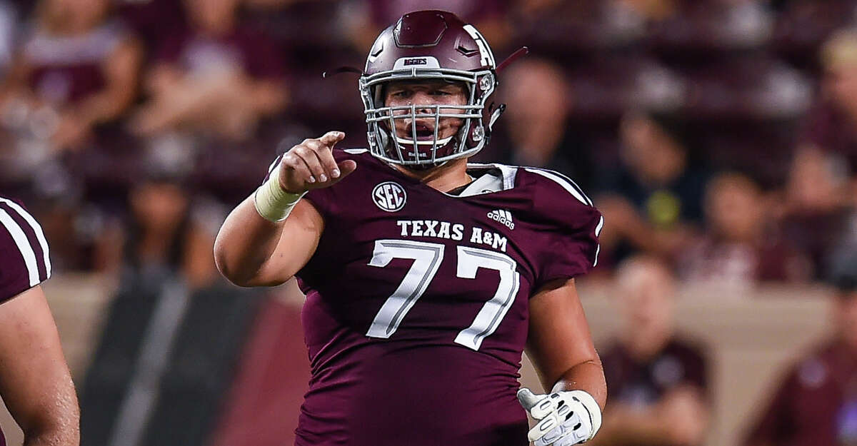 COLLEGE STATION, TX - AUGUST 30: Texas A&M Aggies center Ryan McCollum (77) points out a blocking assignment during a game between the Northwestern State Demons and the Texas A&M Aggies on August 30, 2018 at Kyle Field in College Station, Texas. (Photo by Daniel Dunn/Icon Sportswire via Getty Images)