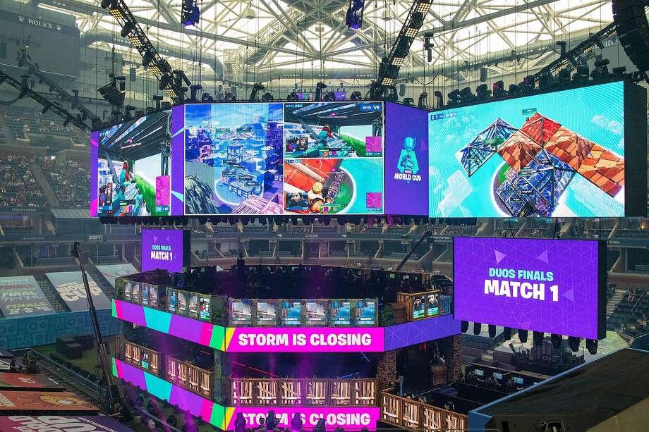 "The ""Fortnite"" World Cup at Arthur Ashe Stadium in New York drew tons of attention in July. Epic Games, which introduced an online service in December, wants to change the way people buy video games. Photo: Photos By Brian Finke / New York Times"