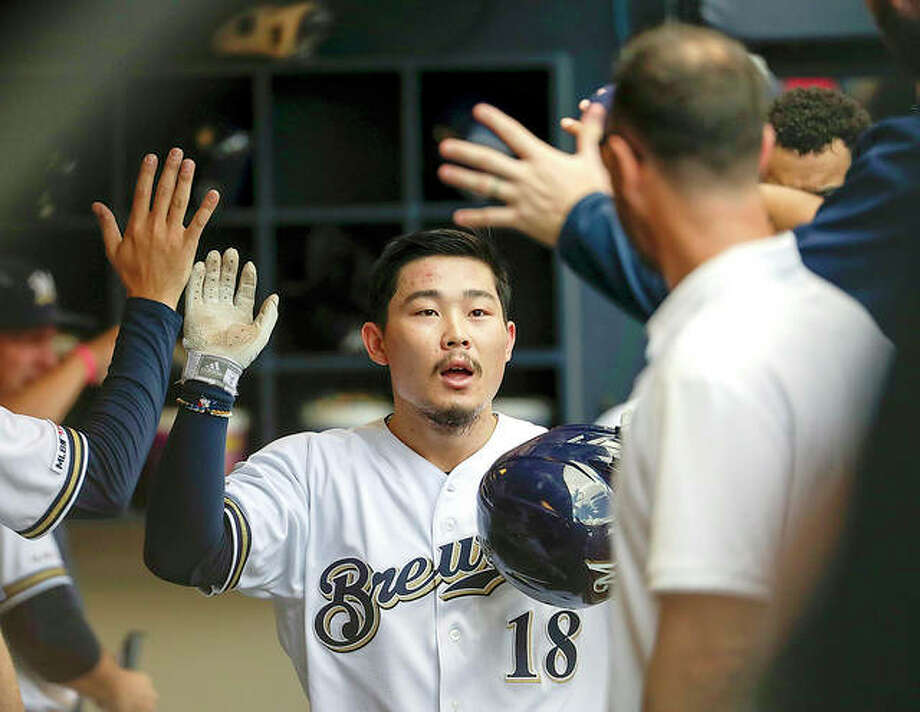 The Brewers' Keston Hiura is congratulated after hitting a home run in the fourth inning of Wednesday's game in Milwaukee against the Cardinals. Photo: AP Photo