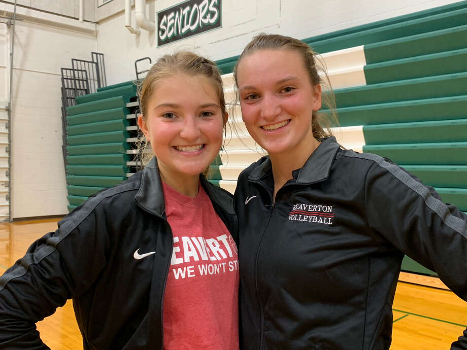 Beaverton junior setter Mady Pahl (left) and junior hitter Molly Gerow pose together following Wednesday's Freeland quad. Photo: Fred Kelly/fred.kelly@mdn.net