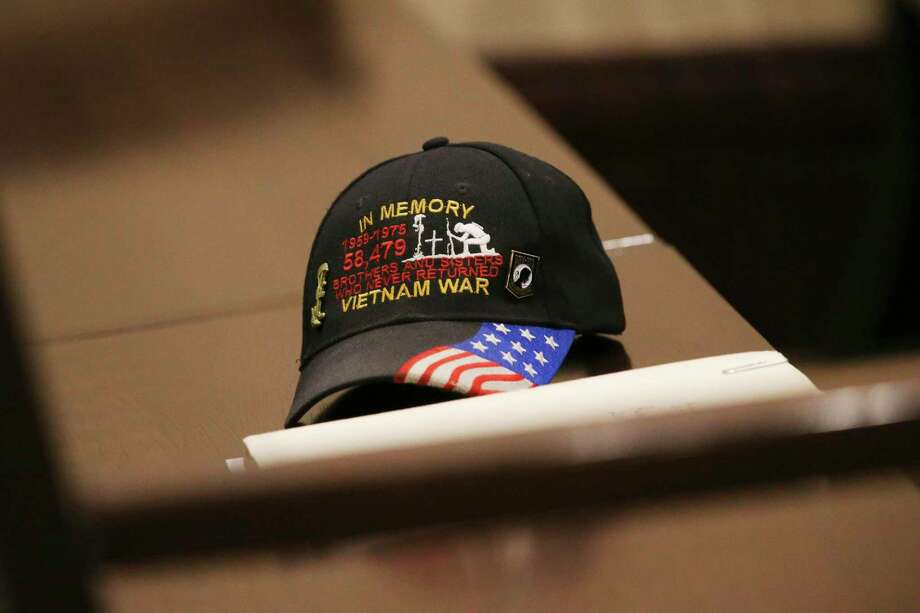 A veteran leaves his cap on a bench as he appears before Bexar County 186th Criminal District Court Judge Jefferson Moore during Felony Veteran's Treatment Court, Thursday, August 30, 2018. It is a relatively new court that is targeted at veterans who suffer from mental illness or drug addiction and have gotten into the criminal justice system. An intense program, participants must adhere to counseling and other requirements, and if they are successful, they avoid going to prison. Photo: JERRY LARA / San Antonio Express-News / © 2018 San Antonio Express-News