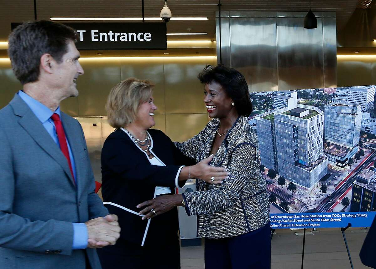 K. Jane Williams, Federal Transportation Administration acting administrator (center), and Nuria Fernandez, Valley Transportation Authority CEO (right), celebrate the news alongsideCarl Guardino, president and CEO of the Silicon Valley Leadership Group and a key booster of the project.