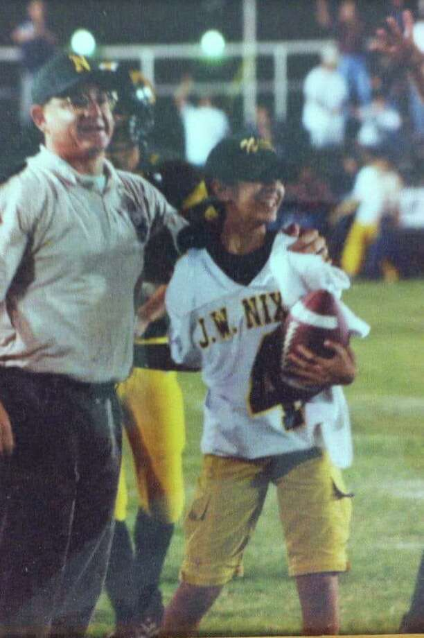 Alex and Robyn Colin are pictured on the sidelines during a 2001 Nixon football game. Photo: Courtesy Photo