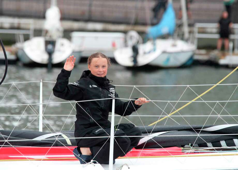 Greta Thunberg, a 16-year-old Swedish climate activist, waves after sailing in New York harbor aboard the Malizia II, Wednesday, Aug. 28, 2019. The zero-emissions yacht left Plymouth, England on Aug. 14. She is scheduled to address the United Nations Climate Action Summit on Sept. 23. (AP Photo/Mary Altaffer) Photo: Mary Altaffer / Copyright 2019 The Associated Press. All rights reserved.