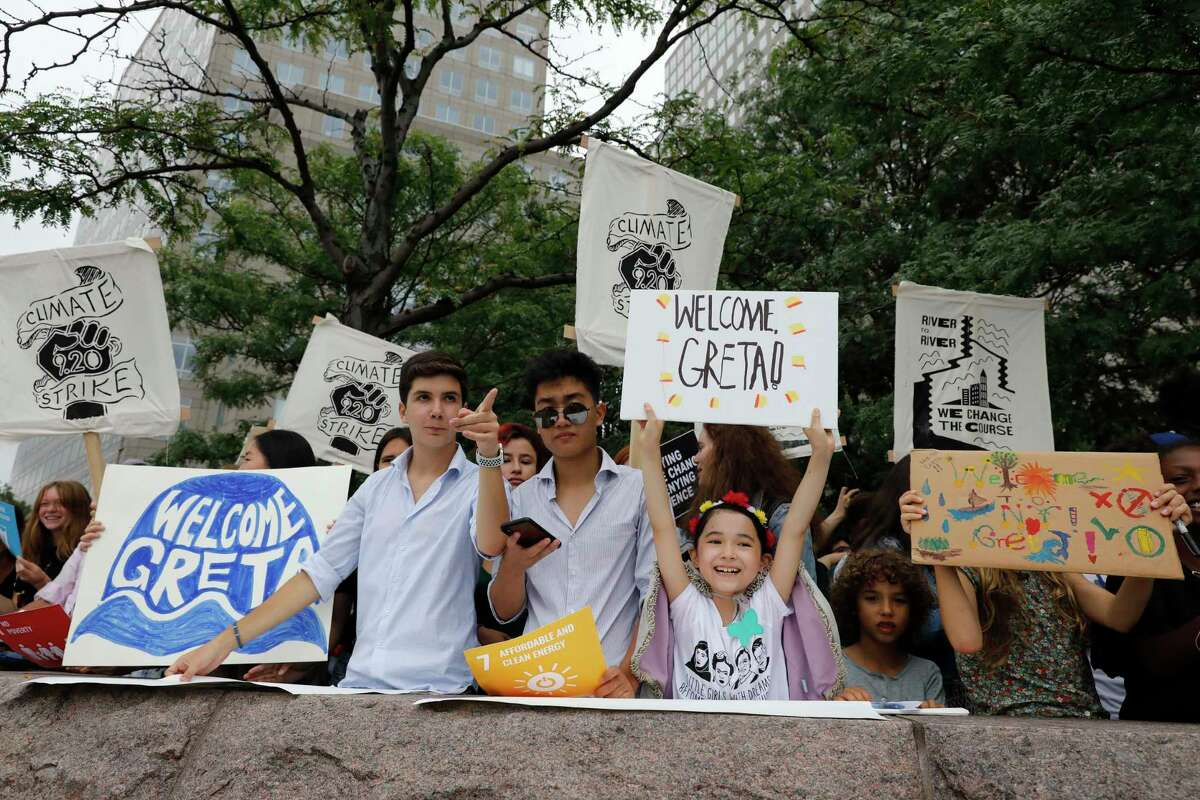 Supporters of Swedish environmental activist Greta Thunberg await her arrival at a marina in New York, Wednesday, Aug. 28, 2019. Thunberg is scheduled to address the United Nations Climate Action Summit on September 23. (AP Photo/Mark Lennihan)