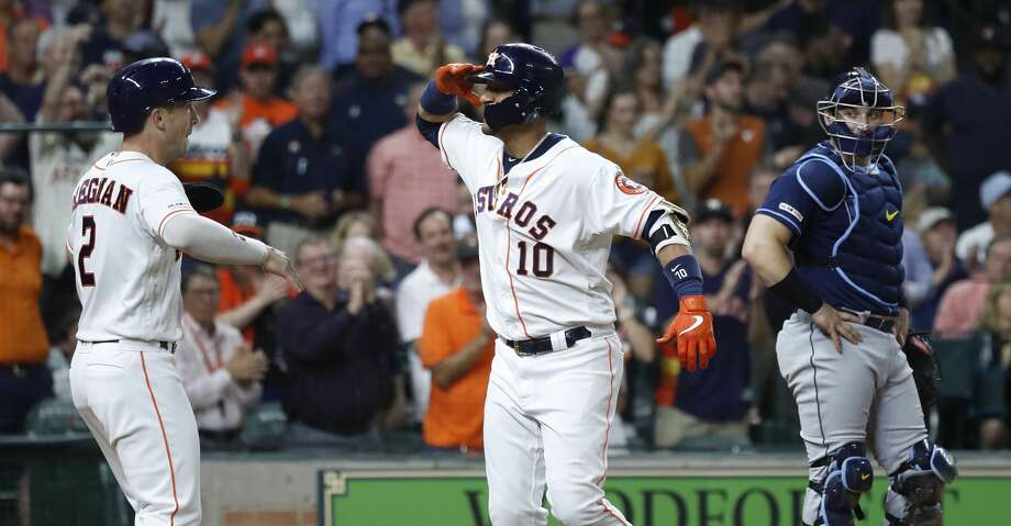 Houston Astros Yuli Gurriel (10) salutes Alex Bregman (2) as they celebrated Gurriel's two-run home run during the fourth inning of an MLB baseball game at Minute Maid Park, Wednesday, August 28, 2019. Photo: Karen Warren/Staff Photographer