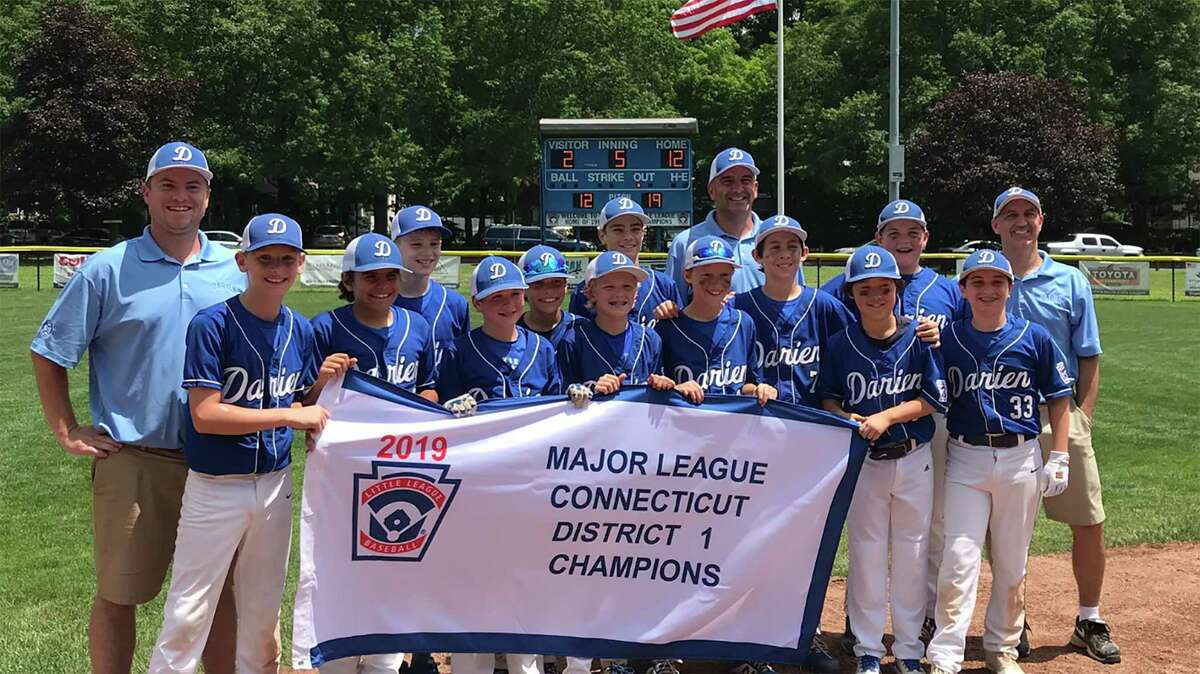 The Darien Little League Baseball team poses for a photo after defeating Stamford North 12-2 to win the 2019 District 1 championship in Stamford on Saturday, July 13.