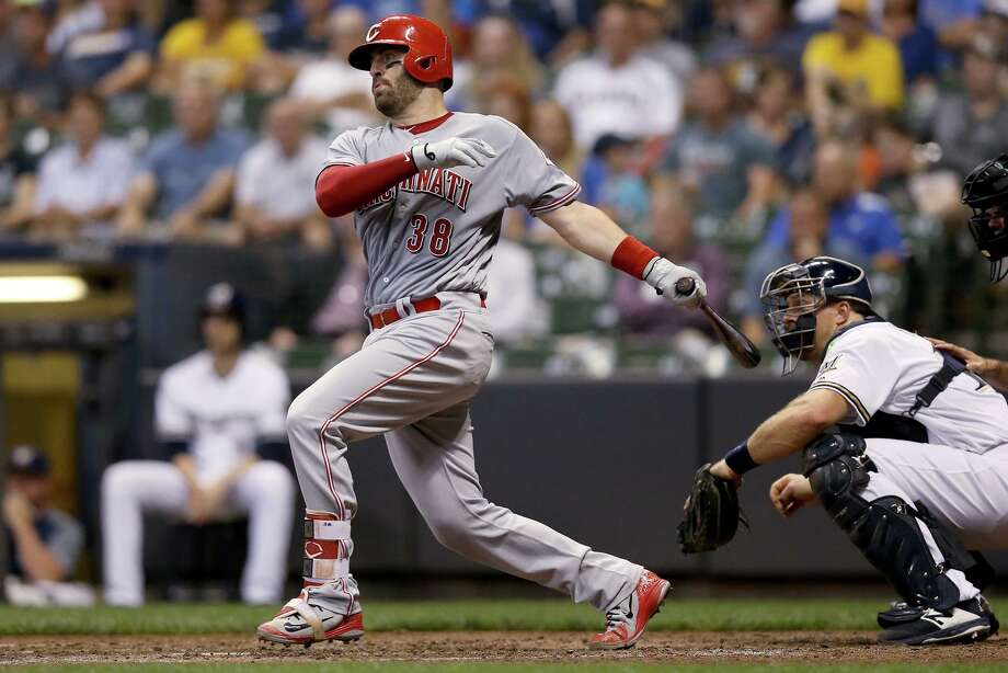Curt Casali of the Cincinnati Reds hits a single in the fourth inning against the Milwaukee Brewers at Miller Park on September 17, 2018. Photo: Dylan Buell / Getty Images / 2018 Getty Images 2018 Getty Images