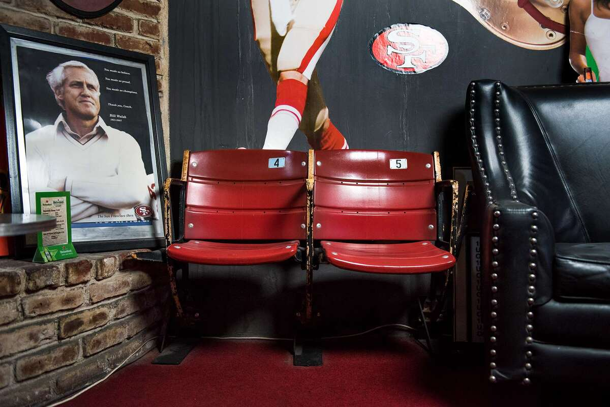 Original Candlestick Park seats are a fixture in the back of Topper bar.
