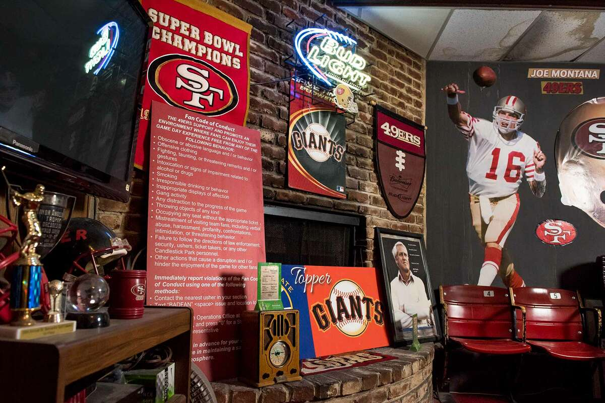 Collected memorabilia is on display around the bar's brick fireplace.