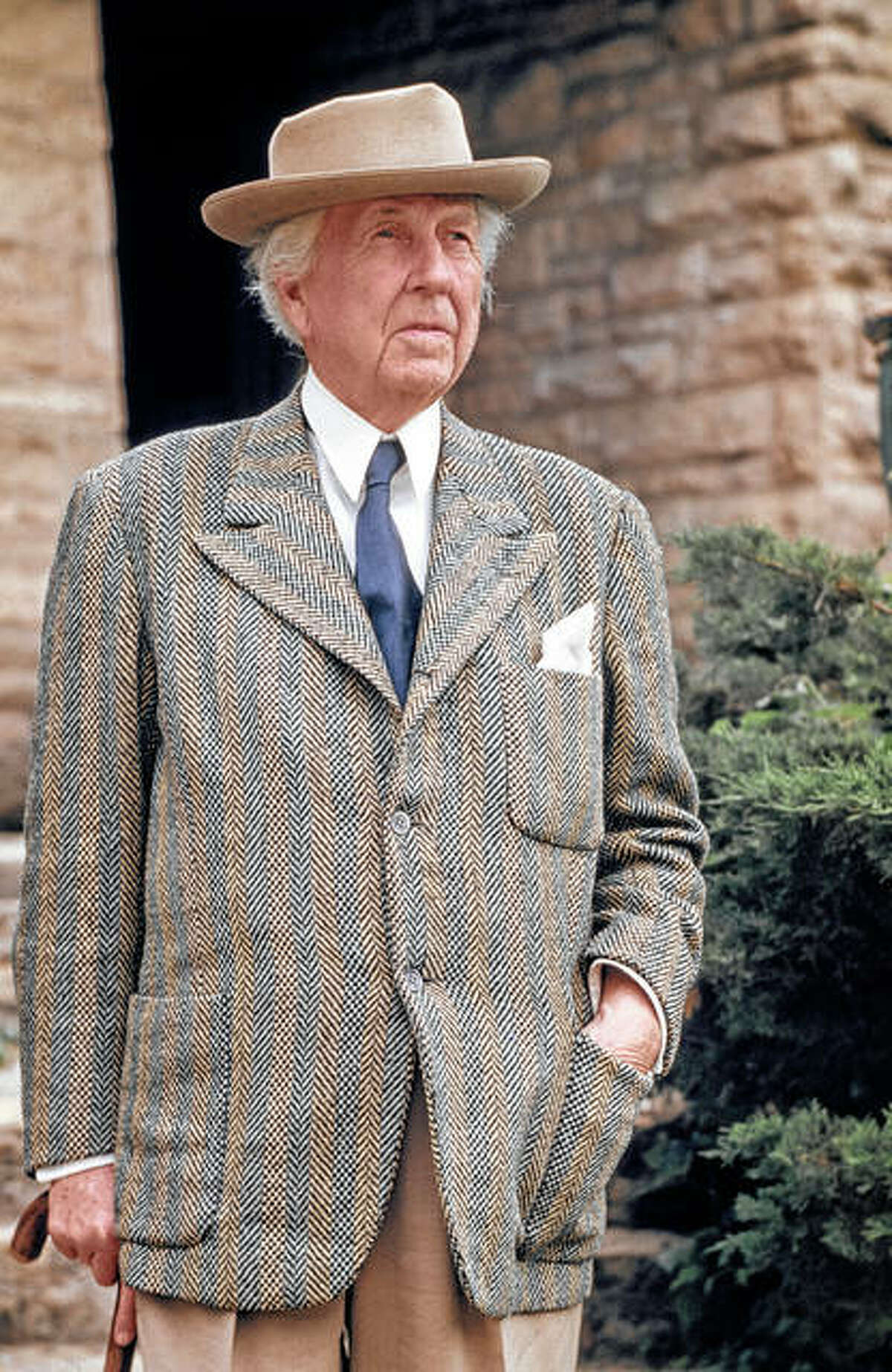 American architect Frank Lloyd Wright stands in 1947 outside Taliesin, the home and school he designed for himself in Spring Green, Wisconsin.