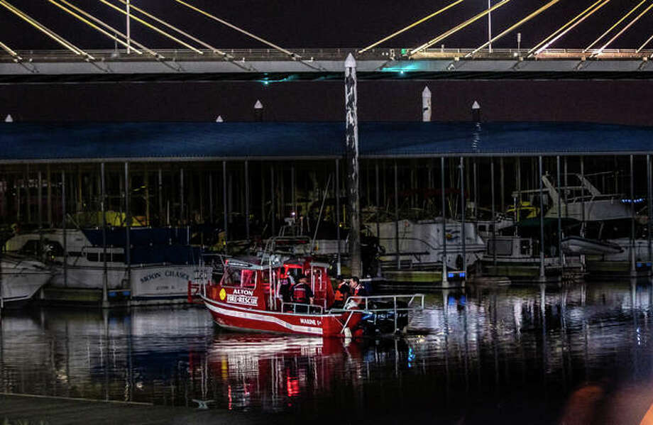 Marine 1 and Alton firefighters prepare to search under the Clark Bridge early Thursday. Photo: Nathan Woodside | The Telegraph