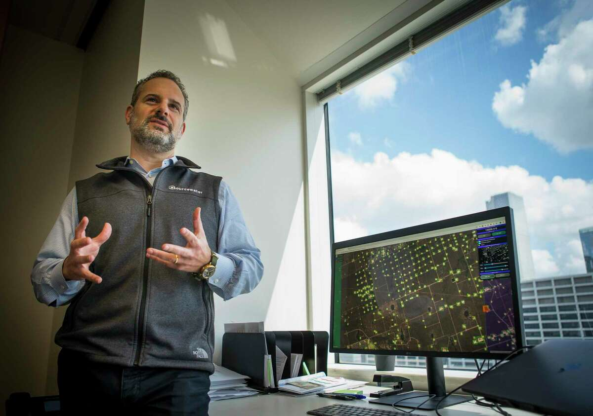 Sourcewater CEO Josh Adler talks about the next steps his company will be taking using satellite imagery at the company's office in downtown Houston, Tuesday, Aug. 13, 2019.The Houston-based company has developed software and artificial intelligence technology that uses satellite images to track oil field activity in the Permian Basin of West Texas and southeastern New Mexico. Service company uses information learned from the images to land sales contracts while exploration and production companies use them to monitor competitors. With several companies now providing similar services, satellite images have become an increasingly popular tool within the oil & gas industry.