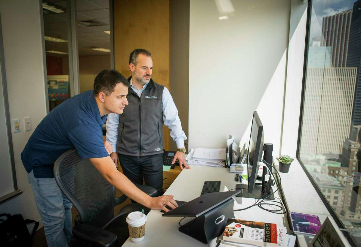 Senior full stack engineer Victor Belous and Sourcewater CEO Josh Adler look at satellite imagery at the company's office in downtown Houston, Tuesday, Aug. 13, 2019.The Houston-based company has developed software and artificial intelligence technology that uses satellite images to track oil field activity in the Permian Basin of West Texas and southeastern New Mexico. Service company uses information learned from the images to land sales contracts while exploration and production companies use them to monitor competitors. With several companies now providing similar services, satellite images have become an increasingly popular tool within the oil & gas industry.
