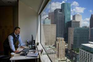 Sourcewater CEO Josh Adler looks at satellite imagery at the company's office in downtown Houston, Tuesday, Aug. 13, 2019.The Houston-based company has developed software and artificial intelligence technology that uses satellite images to track oil field activity in the Permian Basin of West Texas and southeastern New Mexico. Service company uses information learned from the images to land sales contracts while exploration and production companies use them to monitor competitors. With several companies now providing similar services, satellite images have become an increasingly popular tool within the oil & gas industry.