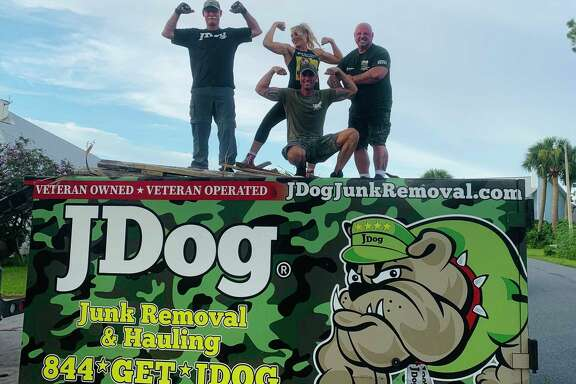 JDog Junk Removal & Hauling Houston owner Tim Colomer (far right) will be featured on Lifetime's Military Makeover.