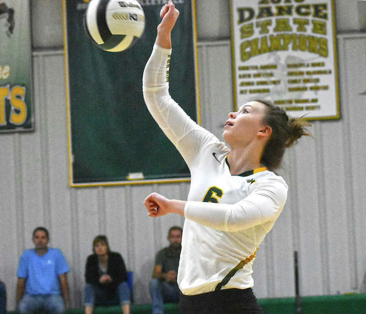 MELHS hitter Anna Kienle puts a swing on a ball late in the first game against Alton.