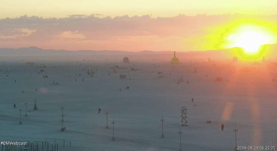 A colorful sunrise stunned at Burning Man on Aug. 29, 2019. High clouds and dust in the air created perfect conditions for drama in the sky. Photo: Burning Man Live Stream