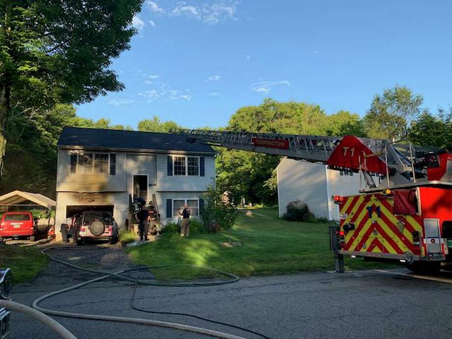 A homeowner was treated for smoke inhalation while trying to put out a garage fire with a garden hose at 111 Roberts St. in Torrington on Thursday, Aug. 29, 2019. The Red Cross was contacted to assist the family as the house was not habitable due to the amount of smoke damage and loss of power. Photo: Torrington Fire Department Photo