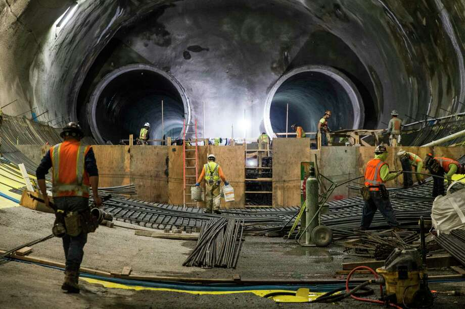 Workers continue construction on the two main tunnels and platform location for the future Central Subway near Stockton and Washington streets Tuesday, April 3, 2018 in San Francisco, Calif. Photo: Jessica Christian / The Chronicle / ONLINE_YES