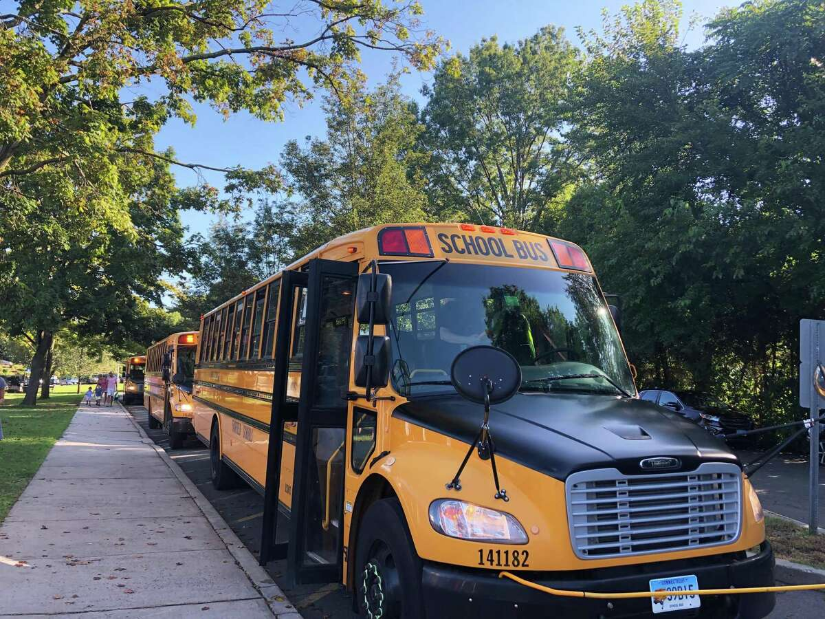 Buses lined up for the first day at Riverfield Elementary School.