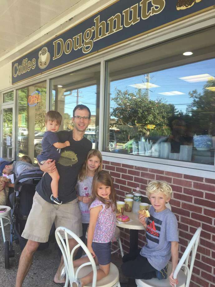 From left, the Gorski family at Darien Doughnut, Arthur, 1, David, Annabelle, 8, standing, Alice, at the table, with August, 6. Photo: Dave Gorski