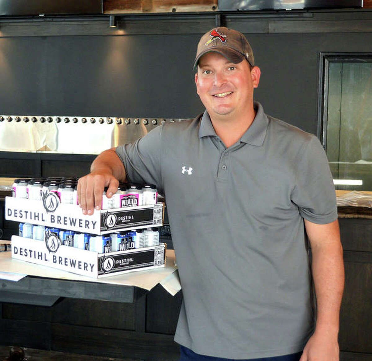 Ryan High, owner of Global Brew Tap House in Edwardsville, shows some of the first cases of beer delivered to the new Global Brew location at 2320 Plum St. in the Ironworks development. The bar will move to its new location after the original location, at 112 S. Buchanan St., closes on Sunday.