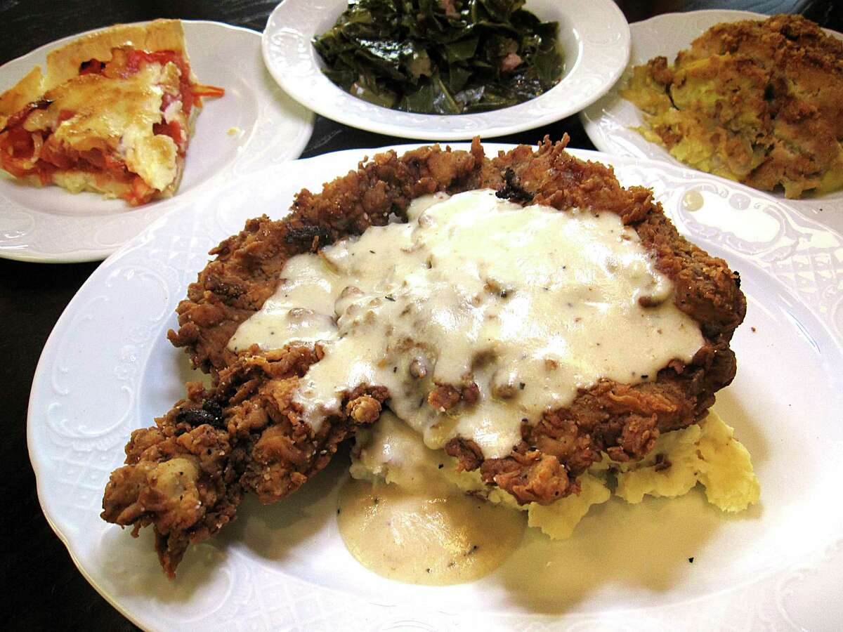 Chicken-fried steak comes with cream gravy and mashed potatoes at Fontaine's Southern Diner & Bar. Optional sides include tomato pie, collard greens and squash casserole.