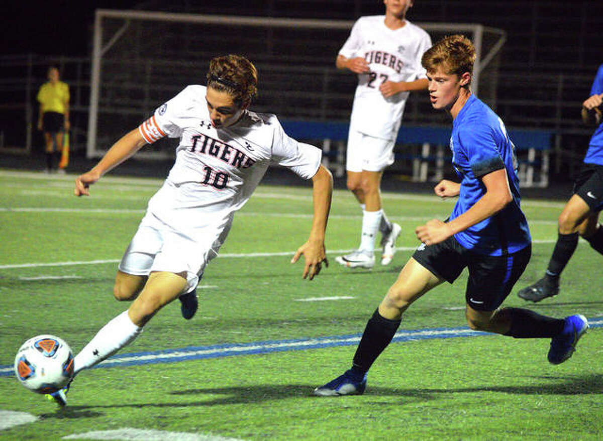 Edwardsville's Jakob Doyle, left, tries to get past a Columbia defender during Wednesday's Metro Cup season opener at Columbia.