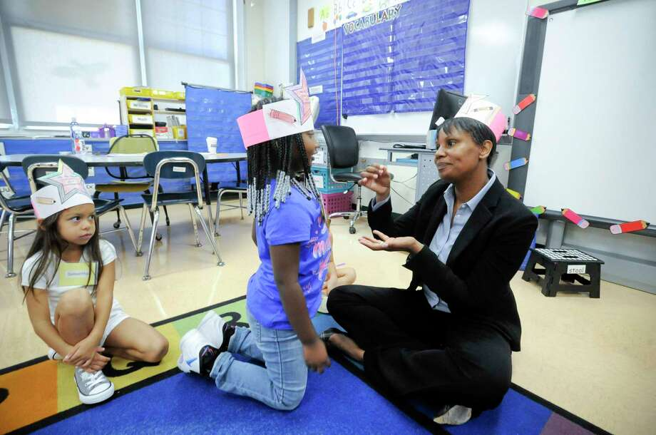 Superintendent Tamu Lucero sits with students and has a pretend cup of tea with Brielle, a kindergartener in Miss Melissa Sempey's class at KT Murphy School, while visiting classes on the first day of school on August 29, 2019 in Stamford, Connecticut. Photo: Matthew Brown / Hearst Connecticut Media / Stamford Advocate