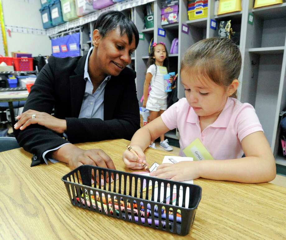 Schools Superintendent Tamu Lucero chats with Gracie, a kindergartener at KT Murphy, during a visit on the first day of school on Aug. 29, 2019 in Stamford, Connecticut. Photo: Matthew Brown / Hearst Connecticut Media / Stamford Advocate