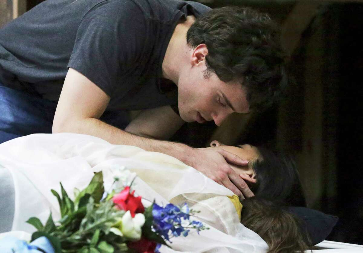 Romeo, Josh Davis, encounters a stricken Juliet, Alyx Gonzales, in the rehearsal for Classic Theatre's staging of